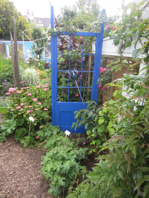 garden path with blue door