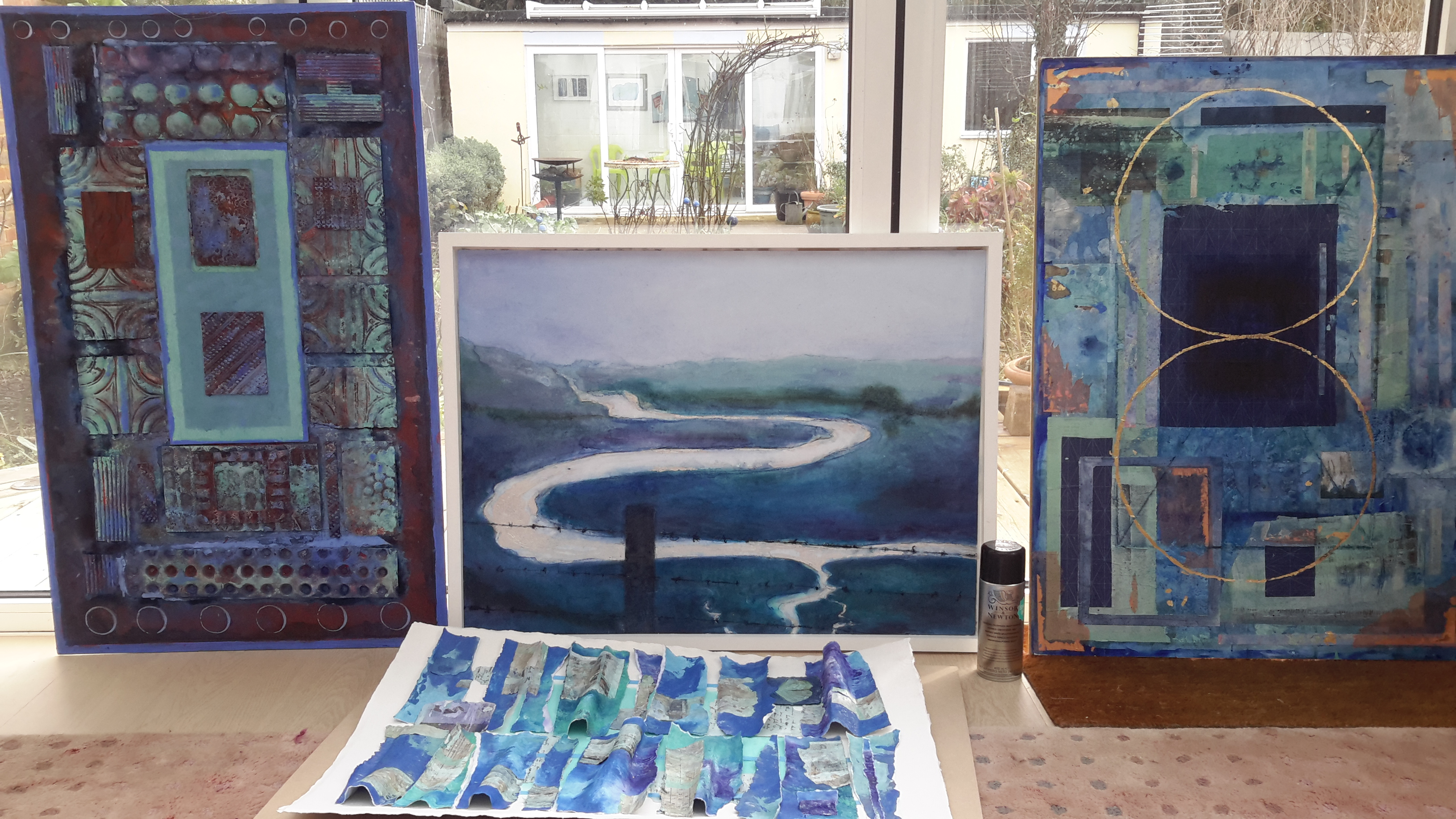 Paintings in blues and greens