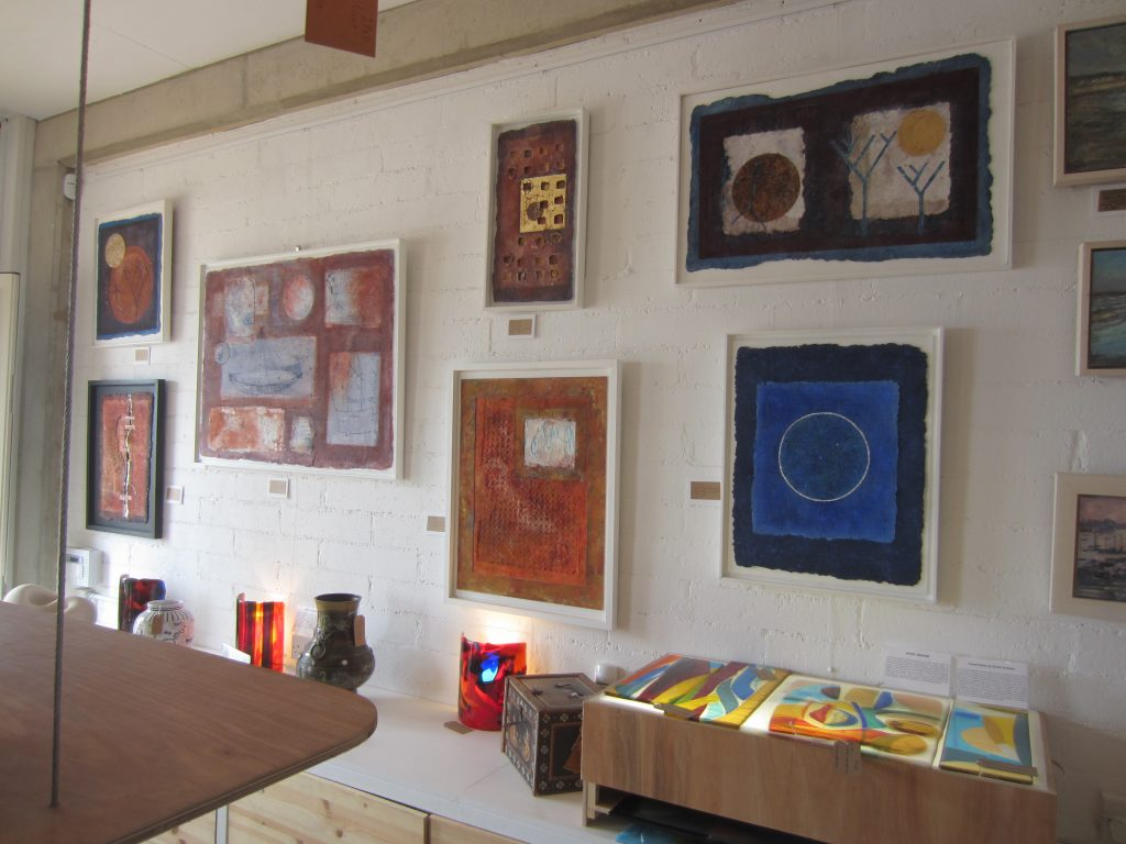 A wall at the beachside gallery in Hove/Brighton which is closing down. My paintings on handmade paper, all sold now, plus glassware and ceramics by Joe Campoli and others.