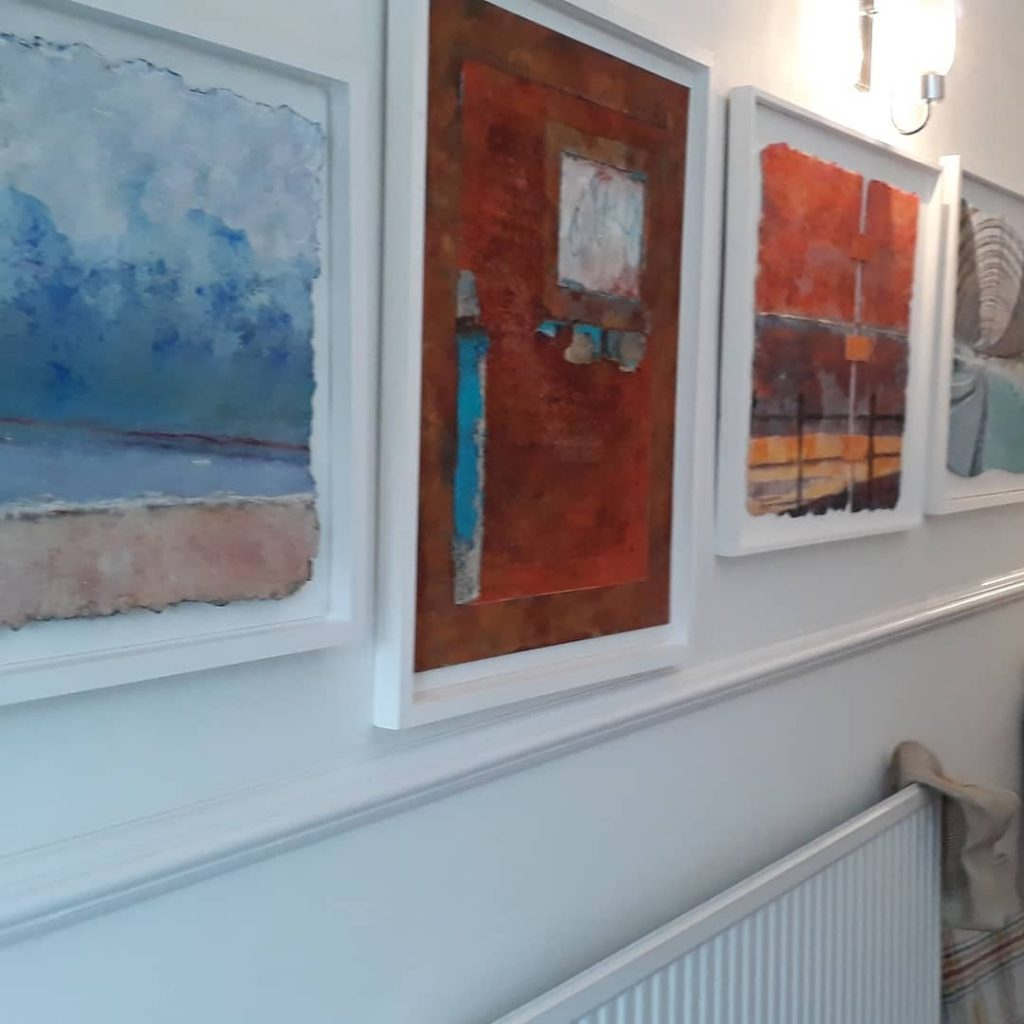 Works on handmade paper in our new hallway. Foreground picture shows a misty day on the N Yorkshire coast very new work.