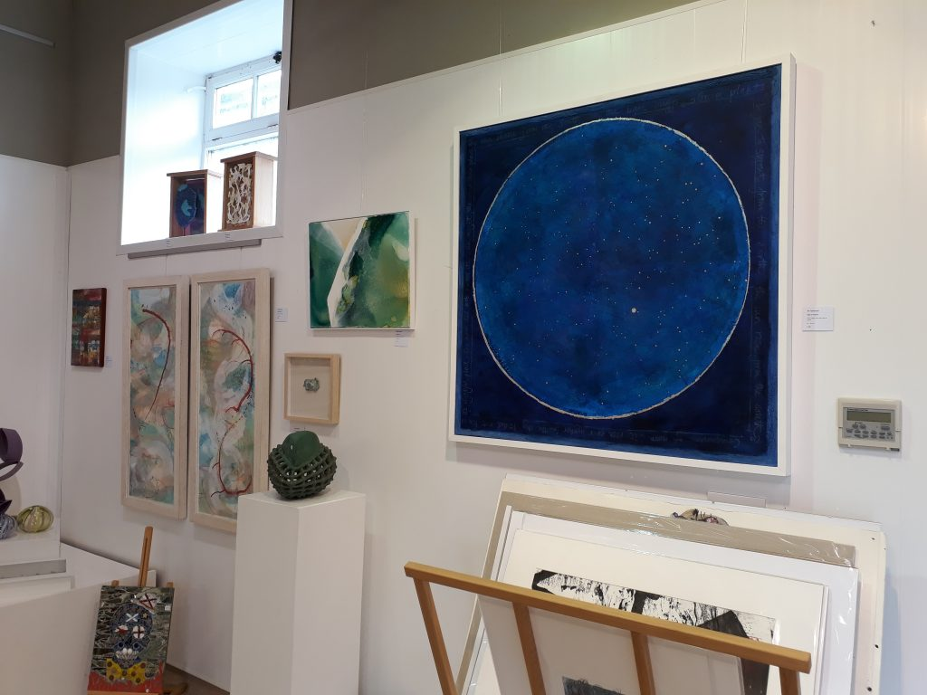 A wall at the Kunsthuis Gallery, Crayke. A large blue night sky on canvas of mine has been given a great position.